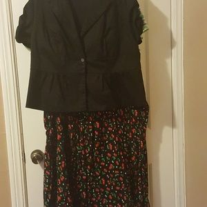 Black blazer, cherry print skirt and red heels.
